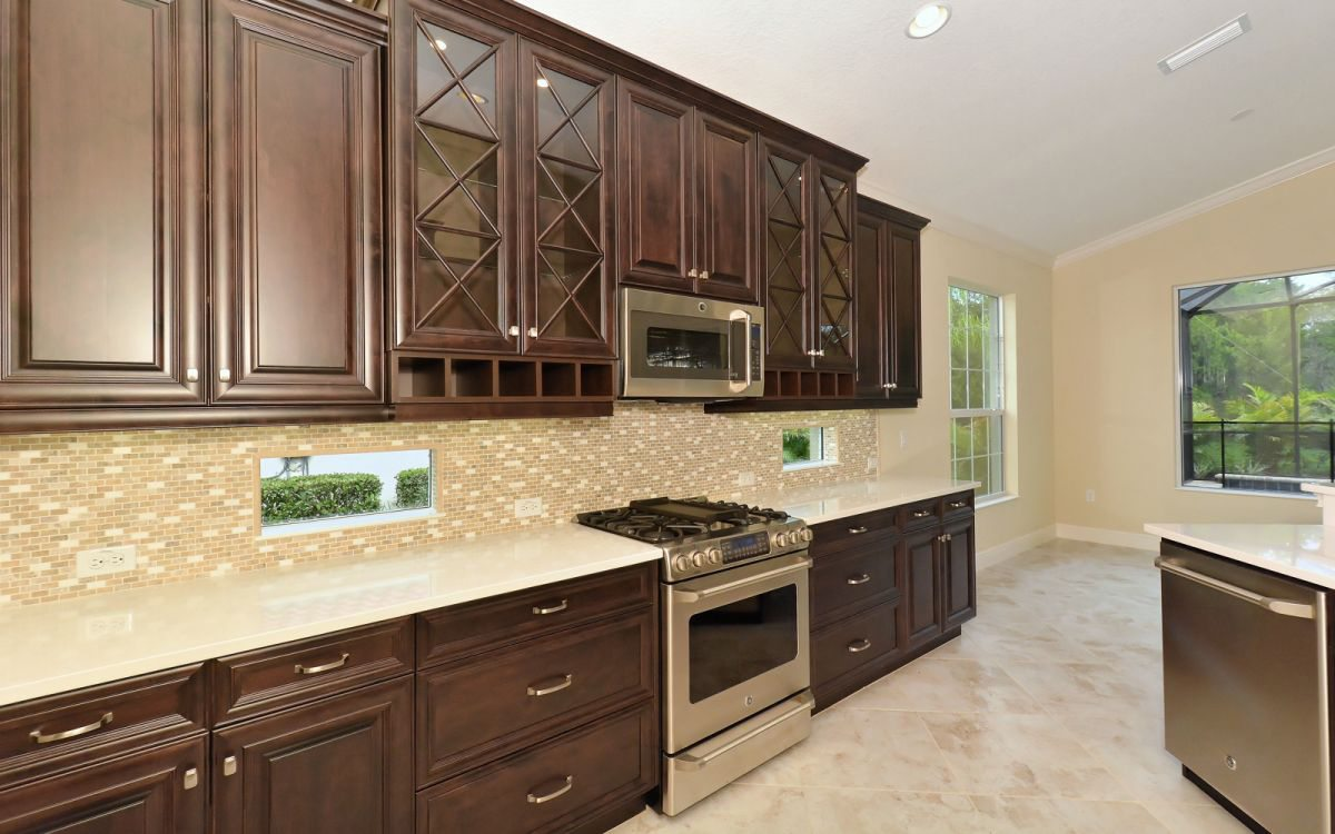 Traditional Kitchen with Custom Cabinets with Triple X Mullions